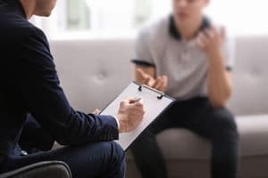 patient talking with therapist in Prescription Drug Abuse Therapy