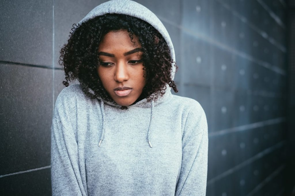 woman in a hoodie is in need of a bipolar disorder treatment center