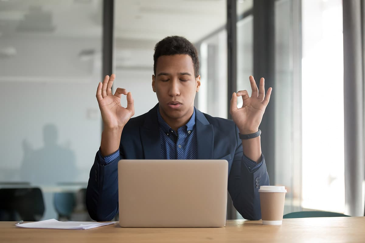a man meditates as one of the common techniques to reduce stress