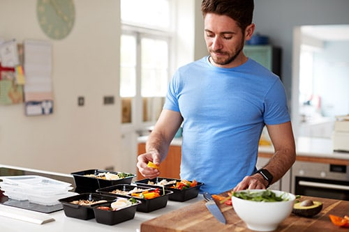 man cooking understanding the connection between nutrition and diet