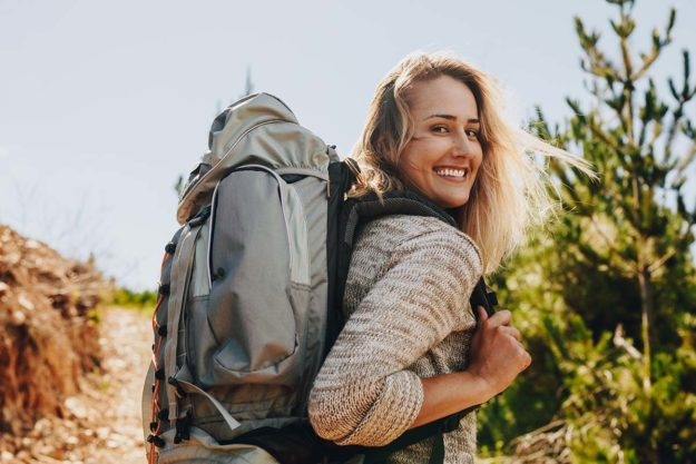 woman smiling showing how Hiking Improves Mental Health