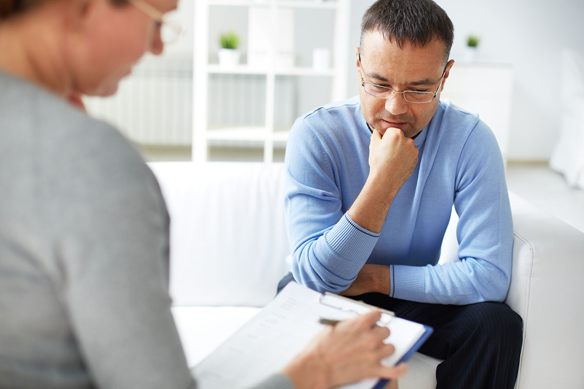 man speaking with a ADHD therapist near Salem County NJ